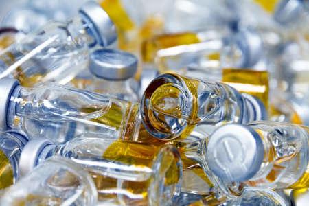 medicinal bottles on a pile photo