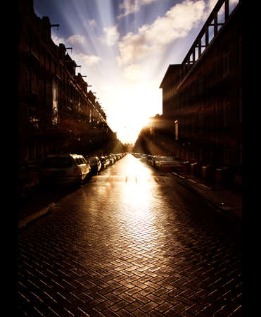 Early morning sunshine on a wet street photo