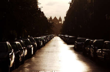 Early morning sunshine on a wet street in Amsterdam photo