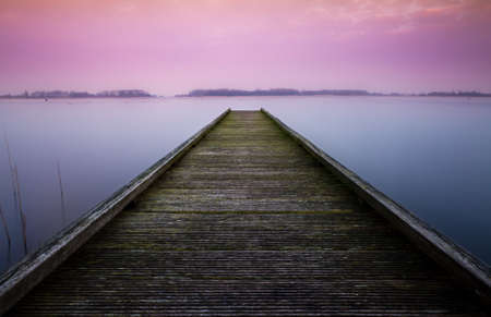 Serene color image of a jetty in a lake  photo