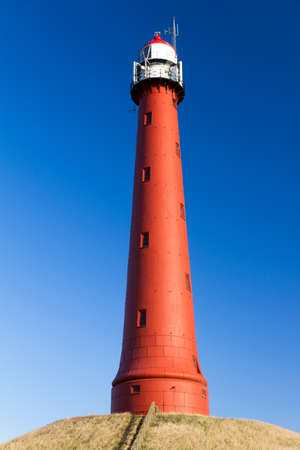 ijmuiden: Red lighthouse in Ijmuiden with a beautiful blue sky Stock Photo
