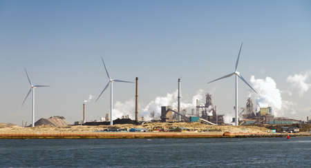 Heavy industry and wind turbines in the harbor of Ijmuiden, The Netherlands photo