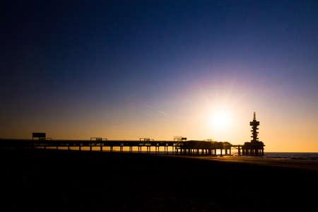 Evening silhouette of the pier of Scheveningen, the Netherlands