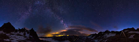 Extraordinary 360 degree panorama of the night sky in the Swiss alps at 2700  metres  Visible is a glow from a city and the majestic milky way above it Stock Photo - 15501428
