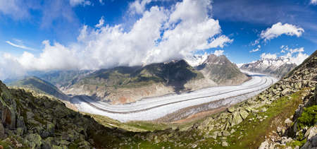 polarised: Extraordinairy panorama of the breathtaking Aletsch glacier as seen from the Bettmer alp in switserland, on a sunny day with clouds in summer