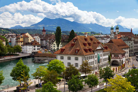 Cityscape of Luzern looking over the river towards the old city with the footbridges