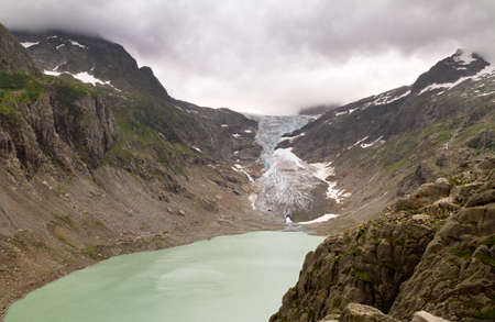 canton berne: The Trift Glacier with its lake in 2012 situated in the Urner Alps in the canton of Berne in Switzerland