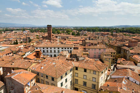 Skyline of the city of Lucca, Italy  Seen from the Torre delle ore towards the Guinigi tower photo