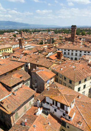 lucca: Skyline of the city of Lucca, Italy  Seen from the Torre delle ore towards the Guinigi tower