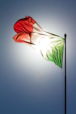 trough: Italian flag with the sun shining trough