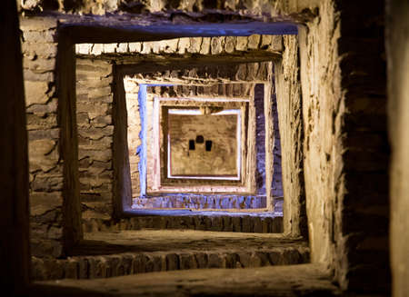 Looking up an ancient staircase in the Torre del mangia in Siena, Italy photo