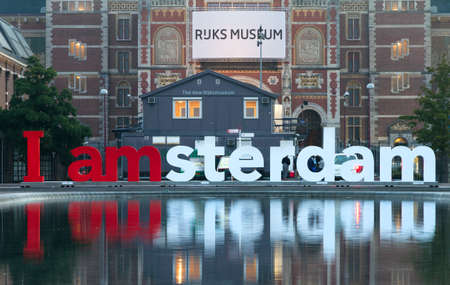 am: I AM Amsterdam reflected in the water on the museum square