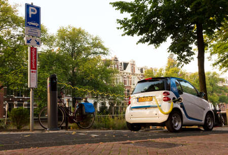 electric automobile: Electric car recharging at a special parking spot in Amsterdam, the Netherlands