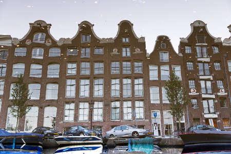 Reflecting townhouses in Amsterdam, the Netherlands