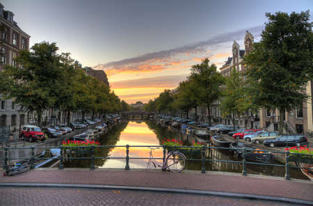 Early morning view from a bridge down a canal in Amsterdam, the Netherlands  HDR photo