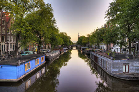 View on a typical canal in Amsterdam, the Netherlands, with houseboats Stock Photo - 17094596