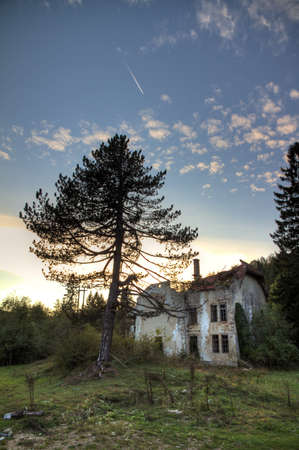 Old abandoned country house in the woods near Plitvice, Croatia   photo