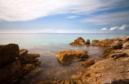 Long exposure image of the rocky coastline of Croatia photo