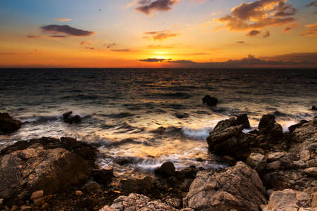 shores: Beautiful sunset in Croatia with rocky shores
