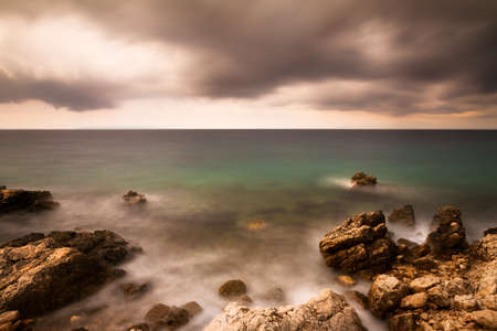 Dark image of a coastline in bad weather in Croatia photo