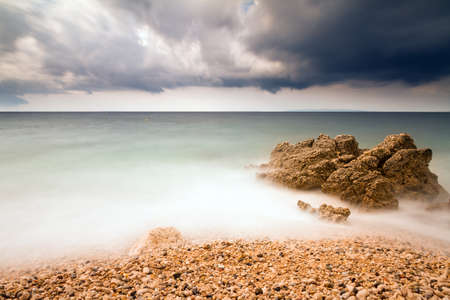 Long exposure image of beach in Croatia with storm weather photo