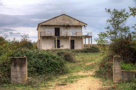 devastation: An abandoned house destroyed by war full of bullet holes