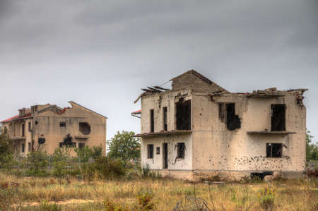 Abandoned houses shot to pieces in the war Stock Photo - 17802538