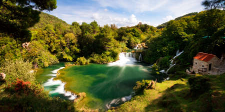 Beautiful long exposure panorama over some waterfalls of the Krka river in Krka national park in Croatia