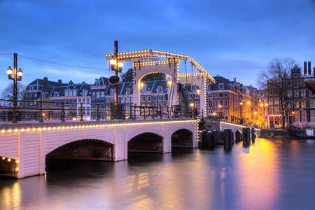 The skinny bridge in Amsterdam, the Netherlands, early in the morning in winter photo
