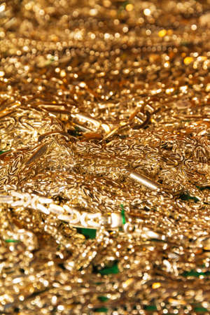 A lot of golden chains on a plate photo