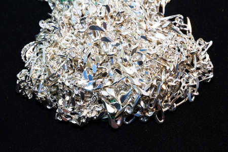 A bunch of silver chains on a pile Stock Photo