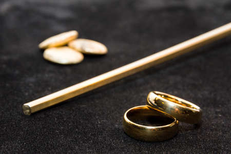 Concept of the process where a lump of gold is transformed into a pair of wedding rings photo