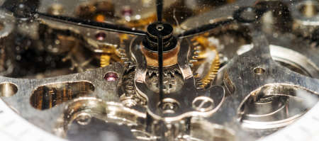 insides: The insides of an antique pocket watch close up Stock Photo