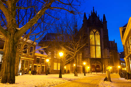 Hooglandsekerkgracht looking at the back of the Hooglandse church in Leiden at twilight in winter with snow in the Netherlands photo