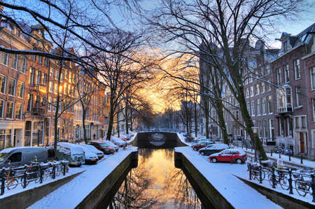 winter sunrise: Beautiful early morning winter view on one of the  city canals of Amsterdam, The Netherlands  HDR