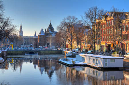 Beautiful early morning winter view on the Nieuwmarkt and the Geldersekade, one of the  city canals of Amsterdam, The Netherlands  HDR