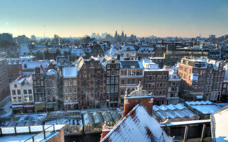 Winter skyline of Amsterdam, the Netherlands, with snow on the rooftops  Looking towards the south with the Rijksmuseum on the horizon  HDR