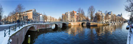 Beautiful winter panorama of the  city canals of Amsterdam, The Netherlands