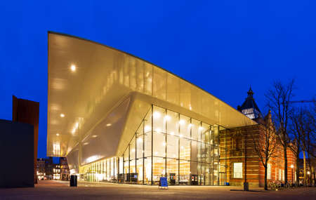 Wide angle panorama of the renovated new wing of the Stedelijk museum  Municipal Museum  Amsterdam, the Netherlands, at twilight