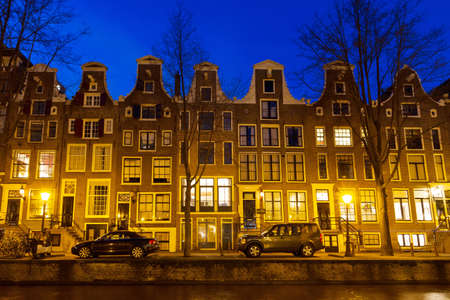 Canal houses at night in Amsterdam, the Netherlands