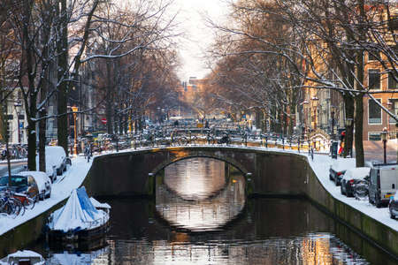 Beautiful early morning winter view on one of city canals of Amsterdam, The Netherlands   photo
