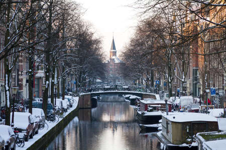 Beautiful early morning winter viewof city canals of Amsterdam, The Netherlands   photo