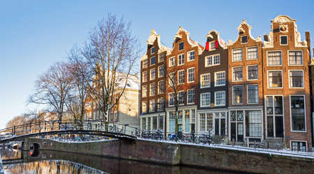 Beautiful early morning winter view on one of the Unesco world heritage city canals of Amsterdam, The Netherlands  에디토리얼