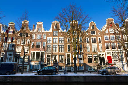 Row of town houses in Amsterdam, the Netherlands, on a sunny winter day photo