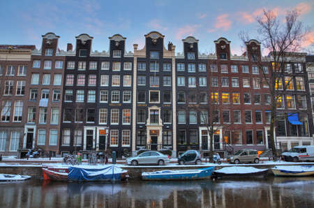 Winter morning canal in Amsterdam, the Netherlands, with town houses  HDR
