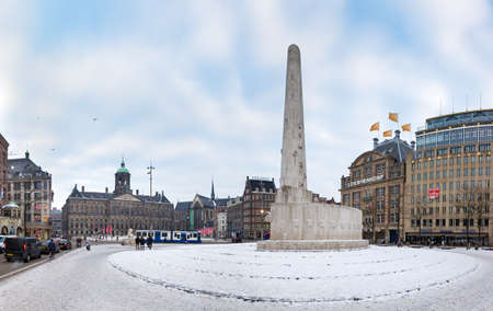 Wide angle view of the Dam square in winter in Amsterdam, the Netherlands