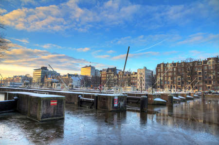 Beautiful winter view on the sluice gates in the river Amstel in Amsterdam, the Netherlands  HDR