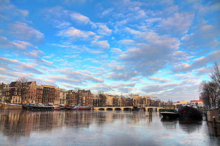 Beautiful winter panorama of the river Amstel and the skinny bridge in Amsterdam, the Netherlands  HDR photo