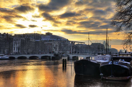 Beautiful winter sunrise over the skinny bridge in Amsterdam, the Netherlands  HDR photo