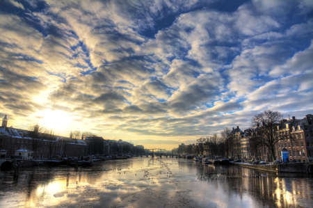 Beautiful winter panorama of the river Amstel in Amsterdam, the Netherlands  HDR